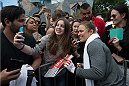MELBOURNE, AUSTRALIA - NOVEMBER 12:  UFC women's bantamweight champion Ronda Rousey of the United States takes pictures with fans at Federation Square on November 12, 2015 in Melbourne, Australia. (Photo by Brandon Magnus/Zuffa LLC/Zuffa LLC via Getty Images)