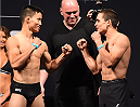 MELBOURNE, AUSTRALIA - NOVEMBER 14:  (L-R) Opponents Ben Nguyen of the United States and Ryan Benoit of the United States face off during the UFC 193 weigh-in at Etihad Stadium on November 14, 2015 in Melbourne, Australia. (Photo by Josh Hedges/Zuffa LLC/Zuffa LLC via Getty Images)