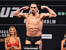 MELBOURNE, AUSTRALIA - NOVEMBER 14: Robert Whittaker of New Zealand weighs in during the UFC 193 weigh-in at Etihad Stadium on November 14, 2015 in Melbourne, Australia. (Photo by Josh Hedges/Zuffa LLC/Zuffa LLC via Getty Images)
