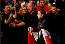 MELBOURNE, AUSTRALIA - NOVEMBER 15: Joanna Jedrzejczyk walks to the Octagon before facing Valerie Letourneau (not pictured) in their UFC women's strawweight championship bout during the UFC 193 event at Etihad Stadium on November 15, 2015 in Melbourne, Australia.  (Photo by Josh Hedges/Zuffa LLC/Zuffa LLC via Getty Images)