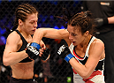 MELBOURNE, AUSTRALIA - NOVEMBER 15:  Valerie Letourneau (R) throws an elbow against Joanna Jedrzejczyk (L) in their UFC women's strawweight championship bout during the UFC 193 event at Etihad Stadium on November 15, 2015 in Melbourne, Australia.  (Photo by Josh Hedges/Zuffa LLC/Zuffa LLC via Getty Images)