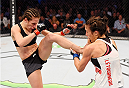 MELBOURNE, AUSTRALIA - NOVEMBER 15: (L-R) Joanna Jedrzejczyk kicks Valerie Letourneau in their UFC women's strawweight championship bout during the UFC 193 event at Etihad Stadium on November 15, 2015 in Melbourne, Australia.  (Photo by Josh Hedges/Zuffa LLC/Zuffa LLC via Getty Images)