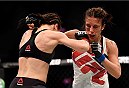 MELBOURNE, AUSTRALIA - NOVEMBER 15:  (L-R) Joanna Jedrzejczyk and Valerie Letourneau exchange punches in their UFC women's strawweight championship bout during the UFC 193 event at Etihad Stadium on November 15, 2015 in Melbourne, Australia.  (Photo by Jeff Bottari/Zuffa LLC/Zuffa LLC via Getty Images)
