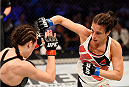 MELBOURNE, AUSTRALIA - NOVEMBER 15:  Valerie Letourneau (R) throws a right-handed punch against Joanna Jedrzejczyk (L) in their UFC women's strawweight championship bout during the UFC 193 event at Etihad Stadium on November 15, 2015 in Melbourne, Australia.  (Photo by Josh Hedges/Zuffa LLC/Zuffa LLC via Getty Images)