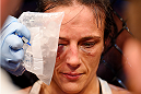 MELBOURNE, AUSTRALIA - NOVEMBER 15:  Valerie Letourneau has an ice pack held to her head during a break in her fight against Joanna Jedrzejczyk (not pictured) in their UFC women's strawweight championship bout during the UFC 193 event at Etihad Stadium on November 15, 2015 in Melbourne, Australia.  (Photo by Josh Hedges/Zuffa LLC/Zuffa LLC via Getty Images)