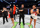 MELBOURNE, AUSTRALIA - NOVEMBER 15:  Referee Steve Perceval (C) announces Joanna Jedrzejczyk (L) winner by Unanimous Decision after five rounds against Valerie Letourneau (R) in their UFC women's strawweight championship bout during the UFC 193 event at Etihad Stadium on November 15, 2015 in Melbourne, Australia.  (Photo by Josh Hedges/Zuffa LLC/Zuffa LLC via Getty Images)