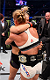 MELBOURNE, AUSTRALIA - NOVEMBER 15:  Holly Holm (R) is congratulated by Ronda Rousey (L) after Holm won by KO (head kick and punches) in two rounds of their UFC women's bantamweight championship bout during the UFC 193 event at Etihad Stadium on November 15, 2015 in Melbourne, Australia.  (Photo by Josh Hedges/Zuffa LLC/Zuffa LLC via Getty Images)