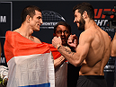 MONTERREY, MEXICO - NOVEMBER 20:  (L-R) Opponents Cesar Arzamendia of Paraguay and Polo Reyes of Mexico face off during the UFC weigh-in at the Arena Monterrey on November 20, 2015 in Monterrey, Mexico. (Photo by Jeff Bottari/Zuffa LLC/Zuffa LLC via Getty Images)