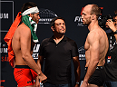 MONTERREY, MEXICO - NOVEMBER 20:  (L-R) Opponents Hector Urbina of Mexico and Bartosz Fabinski of Poland face off during the UFC weigh-in at the Arena Monterrey on November 20, 2015 in Monterrey, Mexico. (Photo by Jeff Bottari/Zuffa LLC/Zuffa LLC via Getty Images)