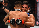 MONTERREY, MEXICO - NOVEMBER 21:  (R-L) Gabriel Benitez of Mexico congratulates opponent Andre Fili of the United States after Fili's knockout victory over Benitez in their featherweight bout during the UFC Fight Night event at Arena Monterrey on November 21, 2015 in Monterrey, Mexico.  (Photo by Jeff Bottari/Zuffa LLC/Zuffa LLC via Getty Images)