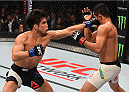 MONTERREY, MEXICO - NOVEMBER 21:  (L-R) Henry Cejudo of the United States punches Jussier Formiga of Brazil in their flyweight bout during the UFC Fight Night event at Arena Monterrey on November 21, 2015 in Monterrey, Mexico.  (Photo by Jeff Bottari/Zuffa LLC/Zuffa LLC via Getty Images)