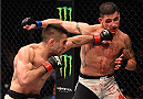 MONTERREY, MEXICO - NOVEMBER 21:  (L-R) Ricardo Lamas of the United States punches Diego Sanchez of the United States in their featherweight bout during the UFC Fight Night event at Arena Monterrey on November 21, 2015 in Monterrey, Mexico.  (Photo by Jeff Bottari/Zuffa LLC/Zuffa LLC via Getty Images)