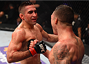MONTERREY, MEXICO - NOVEMBER 21:  (L-R) Opponents Ricardo Lamas of the United States and Diego Sanchez of the United States shake hands after their featherweight bout during the UFC Fight Night event at Arena Monterrey on November 21, 2015 in Monterrey, Mexico.  (Photo by Jeff Bottari/Zuffa LLC/Zuffa LLC via Getty Images)