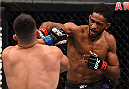 MONTERREY, MEXICO - NOVEMBER 21:  (R-L) Neil Magny of the United States punches Kelvin Gastelum of the United States in their welterweight bout during the UFC Fight Night event at Arena Monterrey on November 21, 2015 in Monterrey, Mexico.  (Photo by Jeff Bottari/Zuffa LLC/Zuffa LLC via Getty Images)