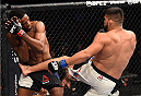 MONTERREY, MEXICO - NOVEMBER 21:  (R-L) Kelvin Gastelum of the United States kicks Neil Magny of the United States in their welterweight bout during the UFC Fight Night event at Arena Monterrey on November 21, 2015 in Monterrey, Mexico.  (Photo by Jeff Bottari/Zuffa LLC/Zuffa LLC via Getty Images)