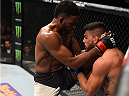 MONTERREY, MEXICO - NOVEMBER 21:  (L-R) Neil Magny of the United States knees Kelvin Gastelum of the United States in their welterweight bout during the UFC Fight Night event at Arena Monterrey on November 21, 2015 in Monterrey, Mexico.  (Photo by Jeff Bottari/Zuffa LLC/Zuffa LLC via Getty Images)