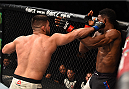 MONTERREY, MEXICO - NOVEMBER 21:  (L-R) Kelvin Gastelum of the United States punches Neil Magny of the United States in their welterweight bout during the UFC Fight Night event at Arena Monterrey on November 21, 2015 in Monterrey, Mexico.  (Photo by Jeff Bottari/Zuffa LLC/Zuffa LLC via Getty Images)