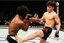 SEOUL, SOUTH KOREA - NOVEMBER 28: Dong Hyun Kim of South Korea kicks Dominique Steele of the United States of America in their lightweight bout during the UFC Fight Night at the Olympic Park Gymnastics Arena on November 28, 2015 in Seoul, South Korea. (Photo by Mitch Viquez/Zuffa LLC/Zuffa LLC via Getty Images)