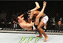 SEOUL, SOUTH KOREA - NOVEMBER 28: Dominique Steele of the United States of America slams Dong Hyun Kim of South Korea which led to a knockout  in their lightweight bout during the UFC Fight Night at the Olympic Park Gymnastics Arena on November 28, 2015 in Seoul, South Korea. (Photo by Mitch Viquez/Zuffa LLC/Zuffa LLC via Getty Images)