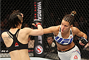 SEOUL, SOUTH KOREA - NOVEMBER 28:  Cortney Casey of the United States of America throws a punch at Seohee Ham of South Korea in their  strawweight bout during the UFC Fight Night at the Olympic Park Gymnastics Arena on November 28, 2015 in Seoul, South Korea. (Photo by Mitch Viquez/Zuffa LLC/Zuffa LLC via Getty Images)