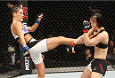 SEOUL, SOUTH KOREA - NOVEMBER 28: Cortney Casey of the United States of America kicks Seohee Ham of South Korea in their  strawweight bout during the UFC Fight Night at the Olympic Park Gymnastics Arena on November 28, 2015 in Seoul, South Korea. (Photo by Mitch Viquez/Zuffa LLC/Zuffa LLC via Getty Images)