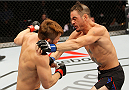 SEOUL, SOUTH KOREA - NOVEMBER 28:  (From L to R) Tae Hyun Bang of South Korea and Leo Kuntz of the United States of America exchange punches in their  lightweight bout during the UFC Fight Night at the Olympic Park Gymnastics Arena on November 28, 2015 in Seoul, South Korea. (Photo by Mitch Viquez/Zuffa LLC/Zuffa LLC via Getty Images)