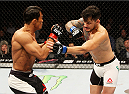 SEOUL, SOUTH KOREA - NOVEMBER 28: Alberto Mina of Brazil throws a punch at Yoshihiro Akiyama of Japan in their  welterweight bout during the UFC Fight Night at the Olympic Park Gymnastics Arena on November 28, 2015 in Seoul, South Korea. (Photo by Mitch Viquez/Zuffa LLC/Zuffa LLC via Getty Images)