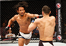 SEOUL, SOUTH KOREA - NOVEMBER 28: Benson Henderson of the United States of America punches Jorge Masvidal of the United States of America  in their welterweight bout during the UFC Fight Night at the Olympic Park Gymnastics Arena on November 28, 2015 in Seoul, South Korea. (Photo by Mitch Viquez/Zuffa LLC/Zuffa LLC via Getty Images)