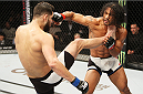 SEOUL, SOUTH KOREA - NOVEMBER 28:  Jorge Masvidal of the United States of America kicks Benson Henderson of the United States of America in their welterweight bout during the UFC Fight Night at the Olympic Park Gymnastics Arena on November 28, 2015 in Seoul, South Korea. (Photo by Mitch Viquez/Zuffa LLC/Zuffa LLC via Getty Images)