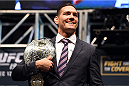 LAS VEGAS, NV - DECEMBER 09:  UFC middleweight champion Chris Weidman poses for photos during the UFC Press Conference inside MGM Grand Garden Arena on December 9, 2015 in Las Vegas, Nevada.  (Photo by Josh Hedges/Zuffa LLC/Zuffa LLC via Getty Images)