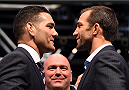 LAS VEGAS, NV - DECEMBER 09:  (L-R) Opponents Chris Weidman and Luke Rockhold face off during the UFC Press Conference inside MGM Grand Garden Arena on December 9, 2015 in Las Vegas, Nevada.  (Photo by Josh Hedges/Zuffa LLC/Zuffa LLC via Getty Images)