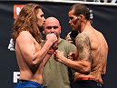LAS VEGAS, NV - DECEMBER 10:   (L-R) Opponents Chris Gruetzemacher and Abner Lloveras of Spain face off during the UFC weigh-in inside MGM Grand Garden Arena on December 10, 2015 in Las Vegas, Nevada.  (Photo by Josh Hedges/Zuffa LLC/Zuffa LLC via Getty Images)