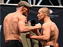 LAS VEGAS, NV - DECEMBER 10:  (L-R) Opponents Ryan LaFlare and Mike Pierce face off during the UFC weigh-in inside MGM Grand Garden Arena on December 10, 2015 in Las Vegas, Nevada.  (Photo by Josh Hedges/Zuffa LLC/Zuffa LLC via Getty Images)