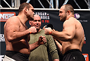 LAS VEGAS, NV - DECEMBER 10:  (L-R) Opponents Gabriel Gonzaga of Brazil and Konstantin Erokhin of Russia face off during the UFC weigh-in inside MGM Grand Garden Arena on December 10, 2015 in Las Vegas, Nevada.  (Photo by Josh Hedges/Zuffa LLC/Zuffa LLC via Getty Images)
