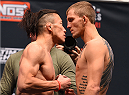 LAS VEGAS, NV - DECEMBER 10:  (L-R) Opponents Tatsuya Kawajiri of Japan and Jason Knight face off during the UFC weigh-in inside MGM Grand Garden Arena on December 10, 2015 in Las Vegas, Nevada.  (Photo by Josh Hedges/Zuffa LLC/Zuffa LLC via Getty Images)