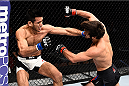 LAS VEGAS, NEVADA - DECEMBER 10: (L) Phillipe Nover punches Zubaira Tukhugov in their featherweight bout during the UFC Fight Night event at The Chelsea at the Cosmopolitan of Las Vegas on December 10, 2015 in Las Vegas, Nevada.  (Photo by Jeff Bottari/Zuffa LLC/Zuffa LLC via Getty Images)
