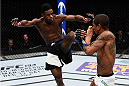 LAS VEGAS, NEVADA - DECEMBER 10:  (L) Aljamain Sterling kicks Johnny Eduardo in their bantamweight bout during the UFC Fight Night event at The Chelsea at the Cosmopolitan of Las Vegas on December 10, 2015 in Las Vegas, Nevada.  (Photo by Jeff Bottari/Zuffa LLC/Zuffa LLC via Getty Images)