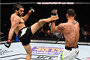 LAS VEGAS, NEVADA - DECEMBER 10:  (L) Elias Theodorou kicks Thiago Santos in their middleweight bout during the UFC Fight Night event at The Chelsea at the Cosmopolitan of Las Vegas on December 10, 2015 in Las Vegas, Nevada.  (Photo by Jeff Bottari/Zuffa LLC/Zuffa LLC via Getty Images)