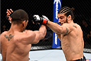 LAS VEGAS, NEVADA - DECEMBER 10:  (R) Elias Theodorou punches Thiago Santos in their middleweight bout during the UFC Fight Night event at The Chelsea at the Cosmopolitan of Las Vegas on December 10, 2015 in Las Vegas, Nevada.  (Photo by Jeff Bottari/Zuffa LLC/Zuffa LLC via Getty Images)