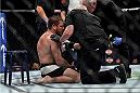 LAS VEGAS, NEVADA - DECEMBER 10:  Jim Miller recovers after his loss to Michael Chiesa in their lightweight bout during the UFC Fight Night event at The Chelsea at the Cosmopolitan of Las Vegas on December 10, 2015 in Las Vegas, Nevada.  (Photo by Brandon Magnus/Zuffa LLC/Zuffa LLC via Getty Images)