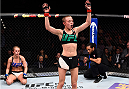 LAS VEGAS, NEVADA - DECEMBER 10:  (R-L) Rose Namajunas celebrates her submission victory over Paige VanZant in their women's strawweight bout during the UFC Fight Night event at The Chelsea at the Cosmopolitan of Las Vegas on December 10, 2015 in Las Vegas, Nevada.  (Photo by Jeff Bottari/Zuffa LLC/Zuffa LLC via Getty Images)