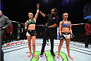 LAS VEGAS, NEVADA - DECEMBER 10:  (L-R) Rose Namajunas celebrates her submission victory over Paige VanZant in their women's strawweight bout during the UFC Fight Night event at The Chelsea at the Cosmopolitan of Las Vegas on December 10, 2015 in Las Vegas, Nevada.  (Photo by Jeff Bottari/Zuffa LLC/Zuffa LLC via Getty Images)