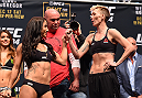 LAS VEGAS, NV - DECEMBER 11:   (L-R) Opponents Tecia Torres and Jocelyn Jones-Lybarger face off during the UFC 194 weigh-in inside MGM Grand Garden Arena on December 10, 2015 in Las Vegas, Nevada.  (Photo by Josh Hedges/Zuffa LLC/Zuffa LLC via Getty Images)