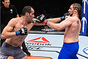 LAS VEGAS, NV - DECEMBER 11: (L-R) Abner Lloveras punches Chris Gruetzemacher in their lightweight bout during the TUF Finale event inside The Chelsea at The Cosmopolitan of Las Vegas on December 11, 2015 in Las Vegas, Nevada.  (Photo by Jeff Bottari/Zuffa LLC/Zuffa LLC via Getty Images) *** Local Caption *** Chris Gruetzemacher; Abner Lloveras