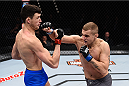 LAS VEGAS, NV - DECEMBER 11: (R-L) Marcin Wrzosek punches Julian Erosa in their lightweight bout during the TUF Finale event inside The Chelsea at The Cosmopolitan of Las Vegas on December 11, 2015 in Las Vegas, Nevada.  (Photo by Jeff Bottari/Zuffa LLC/Zuffa LLC via Getty Images) *** Local Caption *** Julian Erosa; Marcin Wrzosek