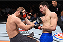 LAS VEGAS, NV - DECEMBER 11: (R-L) Julian Erosa punches Marcin Wrzosek in their lightweight bout during the TUF Finale event inside The Chelsea at The Cosmopolitan of Las Vegas on December 11, 2015 in Las Vegas, Nevada.  (Photo by Jeff Bottari/Zuffa LLC/Zuffa LLC via Getty Images) *** Local Caption *** Julian Erosa; Marcin Wrzosek