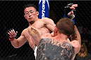 LAS VEGAS, NV - DECEMBER 11: (L-R) Tatsuya Kawajiri kicks Jason Knight in their featherweight bout during the TUF Finale event inside The Chelsea at The Cosmopolitan of Las Vegas on December 11, 2015 in Las Vegas, Nevada.  (Photo by Jeff Bottari/Zuffa LLC/Zuffa LLC via Getty Images) *** Local Caption *** Tatsuya Kawajiri; Jason Knight