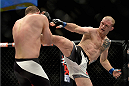 LAS VEGAS, NV - DECEMBER 11: (R-L) Evan Dunham kicks Joe Lauzon in their lightweight bout during the TUF Finale event inside The Chelsea at The Cosmopolitan of Las Vegas on December 11, 2015 in Las Vegas, Nevada.  (Photo by Brandon Magnus/Zuffa LLC/Zuffa LLC via Getty Images) *** Local Caption *** Joe Lauzon; Evan Dunham