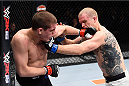 LAS VEGAS, NV - DECEMBER 11: (L-R) Joe Lauzon punches Evan Dunham in their lightweight bout during the TUF Finale event inside The Chelsea at The Cosmopolitan of Las Vegas on December 11, 2015 in Las Vegas, Nevada.  (Photo by Jeff Bottari/Zuffa LLC/Zuffa LLC via Getty Images) *** Local Caption *** Joe Lauzon; Evan Dunham