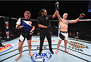 LAS VEGAS, NV - DECEMBER 11: Evan Dunham (right) is declared the winner against Joe Lauzon (left) in their lightweight bout during the TUF Finale event inside The Chelsea at The Cosmopolitan of Las Vegas on December 11, 2015 in Las Vegas, Nevada.  (Photo by Jeff Bottari/Zuffa LLC/Zuffa LLC via Getty Images) *** Local Caption *** Joe Lauzon; Evan Dunham